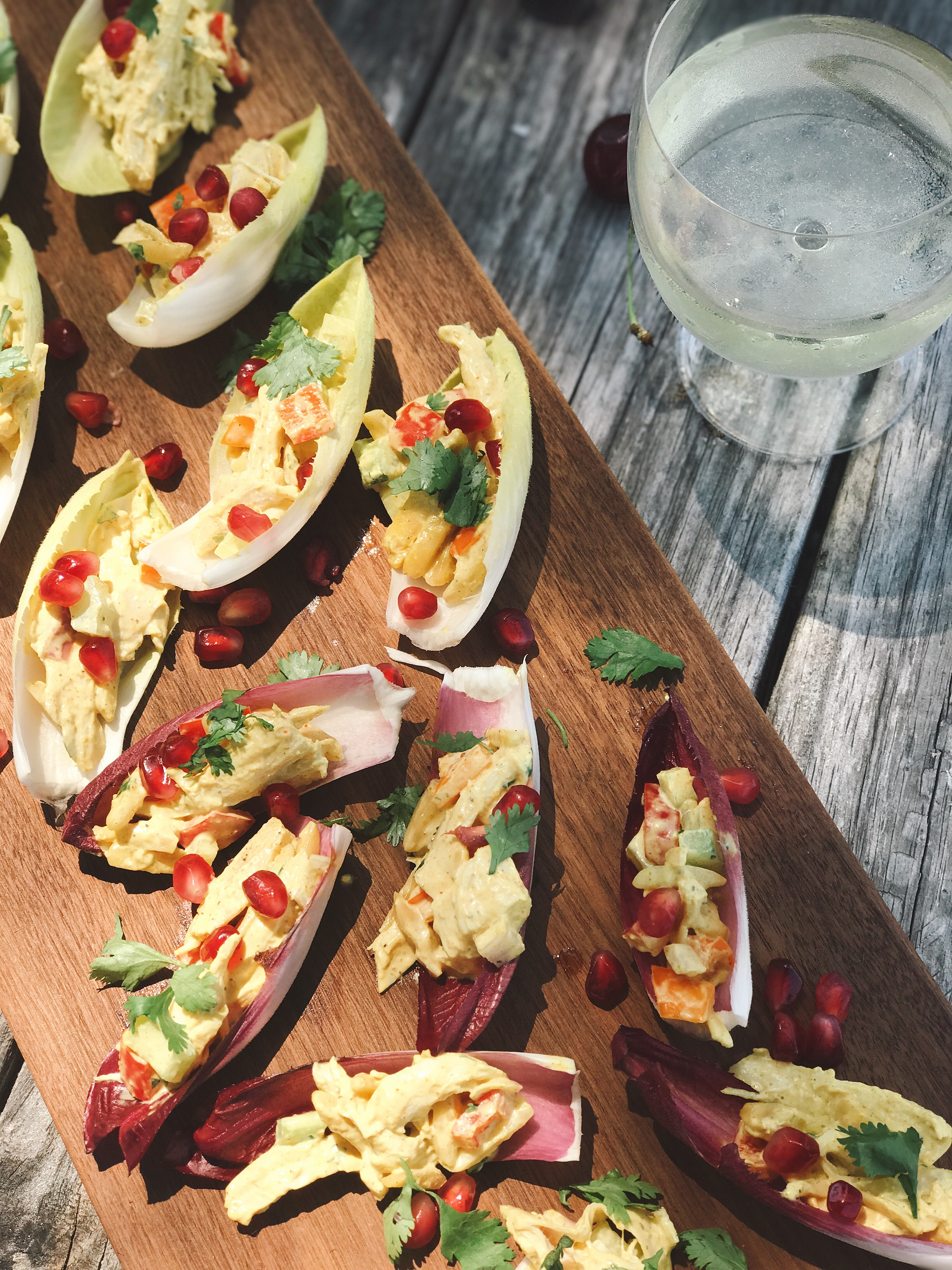 CURRIED CHICKEN SALAD BOATS WITH POMEGRANATE SEEDS // laurenariza.com